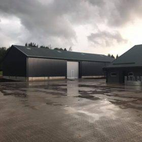 Lauksaimniecības noliktavas un betonēta laukuma, šķūņa demontāžas un jauņa šķūņa būves un bruģēta laukuma būvniecība